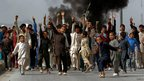 Afghan protesters shout slogans in Kabul (17 Sept 2012)