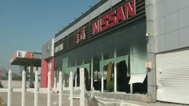 Damaged Nissan car showroom