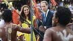 The Duke and Duchess of Cambridge watch a traditional dance at the cultural village in Honiara