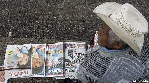 Newspaper vendor in Guatemala