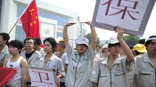 Workers at a plant of the Japanese company Meiko Electronics march with anti-Japan banners during a protest against Tokyo's plans to buy the disputed Diaoyu/Senkaku Islands on 18 September 2012.