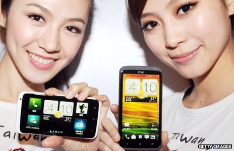 Models hold the HTC One X phones