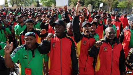 Members of South Africa&#039;s largest labour federation Cosatu greet South African President Jacob Zuma on 17 September 2012 