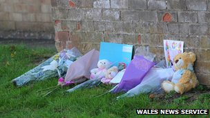 Floral tributes near the scene of a house fire in Cwmbran