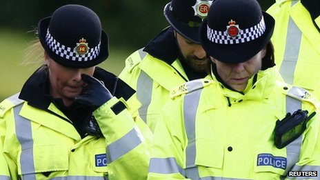 Police officers earlier gathered at the scene of the attacks in Mottram, Tameside