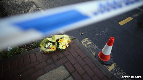 Flowers left at the scene where to police officers were killed in Greater Manchester