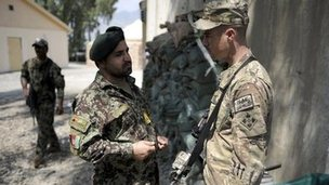 A Afghan officer from the 2nd Kandak, 2nd Brigade, 201st corps of the Afghan National Army and an officer of the 4th brigade combat team 4th infantry division of the U.S. Army talk at Forward Operating Base Joyce, in Kunar