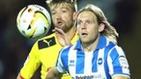 Craig Mackail-Smith of Brighton (right) holds off Neuton of Watford