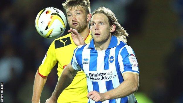 Craig Mackail-Smith of Brighton (right) holds off Neuton of Watford