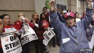 Chicago Teachers Union members, including Carol Baudelaire (R), strike outside Chicago Public Schools headquarters in Chicago September 18, 2012
