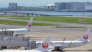 Japan Airlines jets are parked at Tokyo&#039;s Haneda airport 