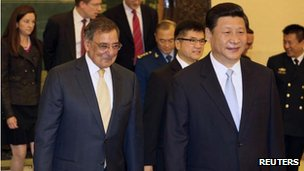 US Secretary of Defence Leon Panetta (L) walks with China's Vice-President Xi Jinping (R) at the Great Hall of the People in Beijing on 19 September, 2012