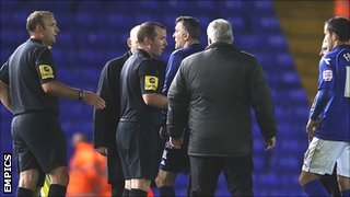 Bolton Wanderers manager Owen Coyle confronts the officials following the 2-1 defeat at Birmingham