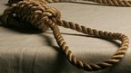 Noose draped on a table