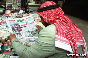 Jordanian man browses newspaper