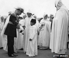 France's Resident-General decorates the future King Hassan II