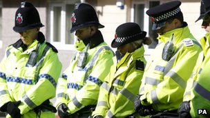 Police officers observe a minute's silence