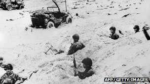 Soldiers of the Allied Expeditionary Corps stand sentry on a beach of Normandy in northern France during the June 1944 operations, after D-Day. Photo: AFP/Getty Images