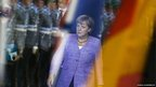 German Chancellor Angela Merkel walks to the arrival ceremony of Croatian's Prime Minister Zoran Milanovic