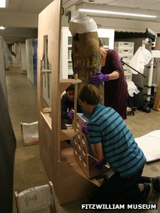 Egyptian mummy case being restored
