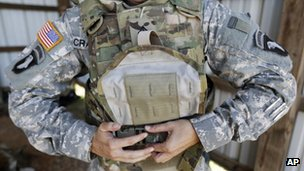 US female soldier removes the new vest in Fort Campbell, Kentucky 18 September 2012