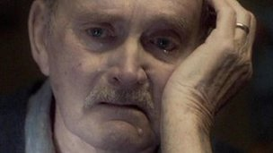 Actor portraying grieving man