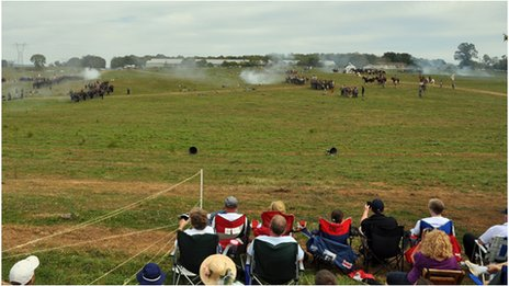 Re-enactors on the field