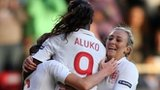 Casey Stoney of England celebrates scoring the third goal