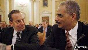 Attorney General Eric Holder chats with Assistant Attorney General Lanny Breuer
