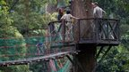 Duke and Duchess of Cambridge next to a canopy walkway in the rainforest