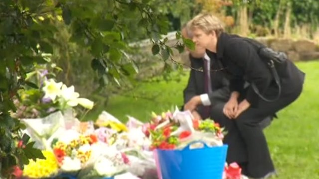 Shadow Home Secretary Yvette Cooper lays flowers