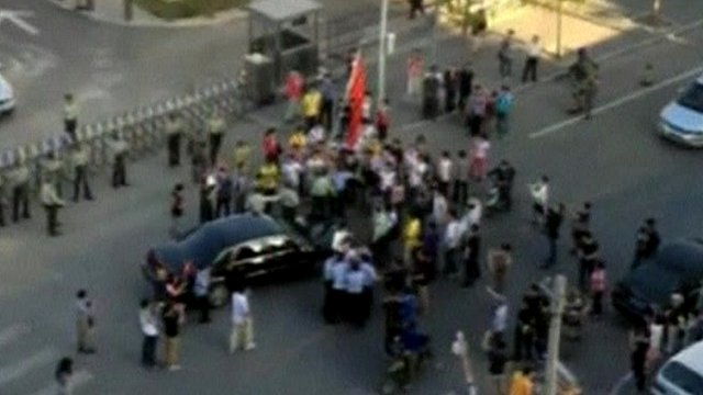 The US ambassador's car surrounded by protesters