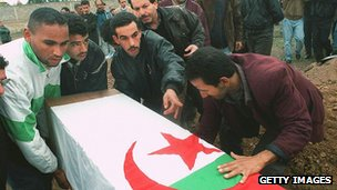 Algerian villagers bury victims of massacre blamed on Islamic militants, 1996