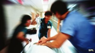 Patient being rushed into A&E