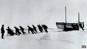 Crew dragging lifeboat