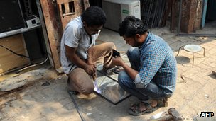 Two men working in Dharavi