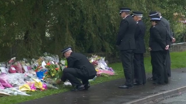 Police laying flowers