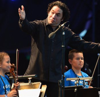 Conductor Gustavo Dudamel with children from Raploch at The Big Concert