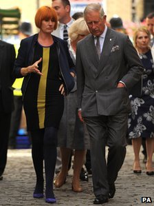 The Prince of Wales talks with Mary Portas during a visit to Surrey Street Market in Croydon, London