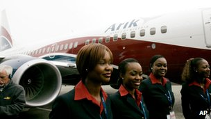 Air stewards stand outside an Arik Air plane in Seattle, US April 2007