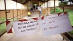 Improvised signs to prevent contamination of other patients and visitors at the Bombali district hospital's cholera ward in Makeni