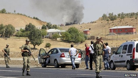 Turkish soldiers seal off an area after a bus is attacked by the armed PKK rebel group