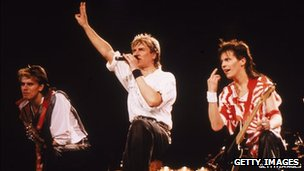Left-right: John Taylor, Simon Le Bon and Andy Taylor on stage in 1984
