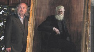 Bill Bailey with portrait of Alfred Russel Wallace