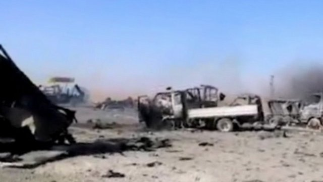 footage of what opposition activists say petrol station bombed by government forces