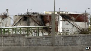 Burnt out Pemex gas tanks at the Petroleos Mexicans pipeline distribution centre 