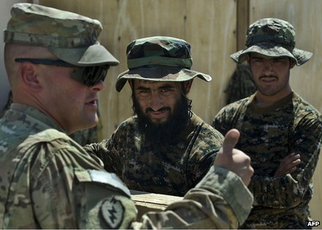 A US soldier (left) speaks to Afghan soldiers at Camp Hero in Kandahar Province, 10 September