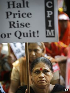 A supporter of Communist Party of India (Marxist) holds a placard in a protest in New Delhi, India,Thursday, Sept. 20, 2012.