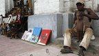 A vendor in Kinshasa, DR Congo, selling Tintin memorabilia