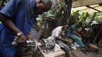 People working at Auguy Kakese's workshop in Kinshasa, DR Congo
